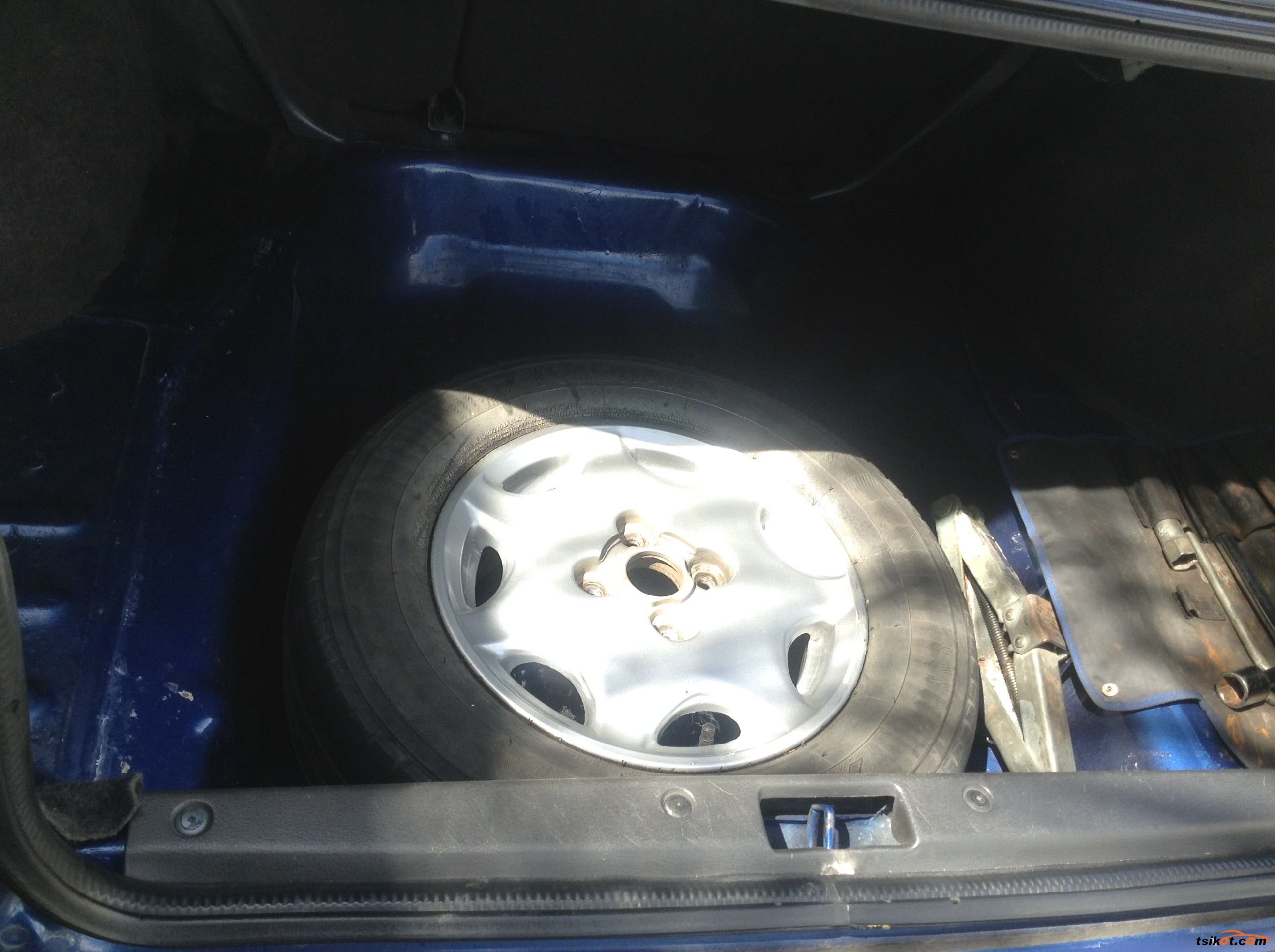 Spare tire on alloy wheels with jack and tire wrench