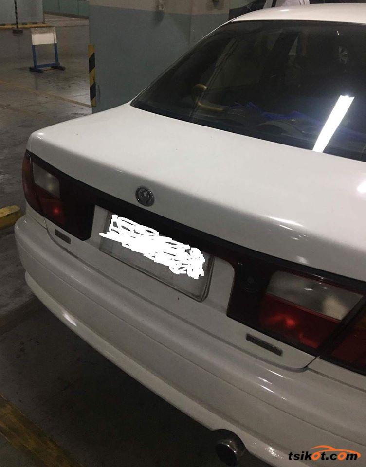 Mazda Familia 1998 - 3