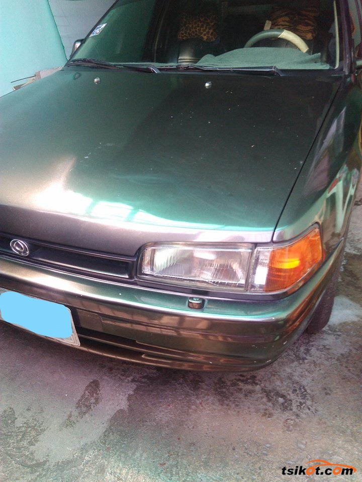 Mazda 323 1997 - 9