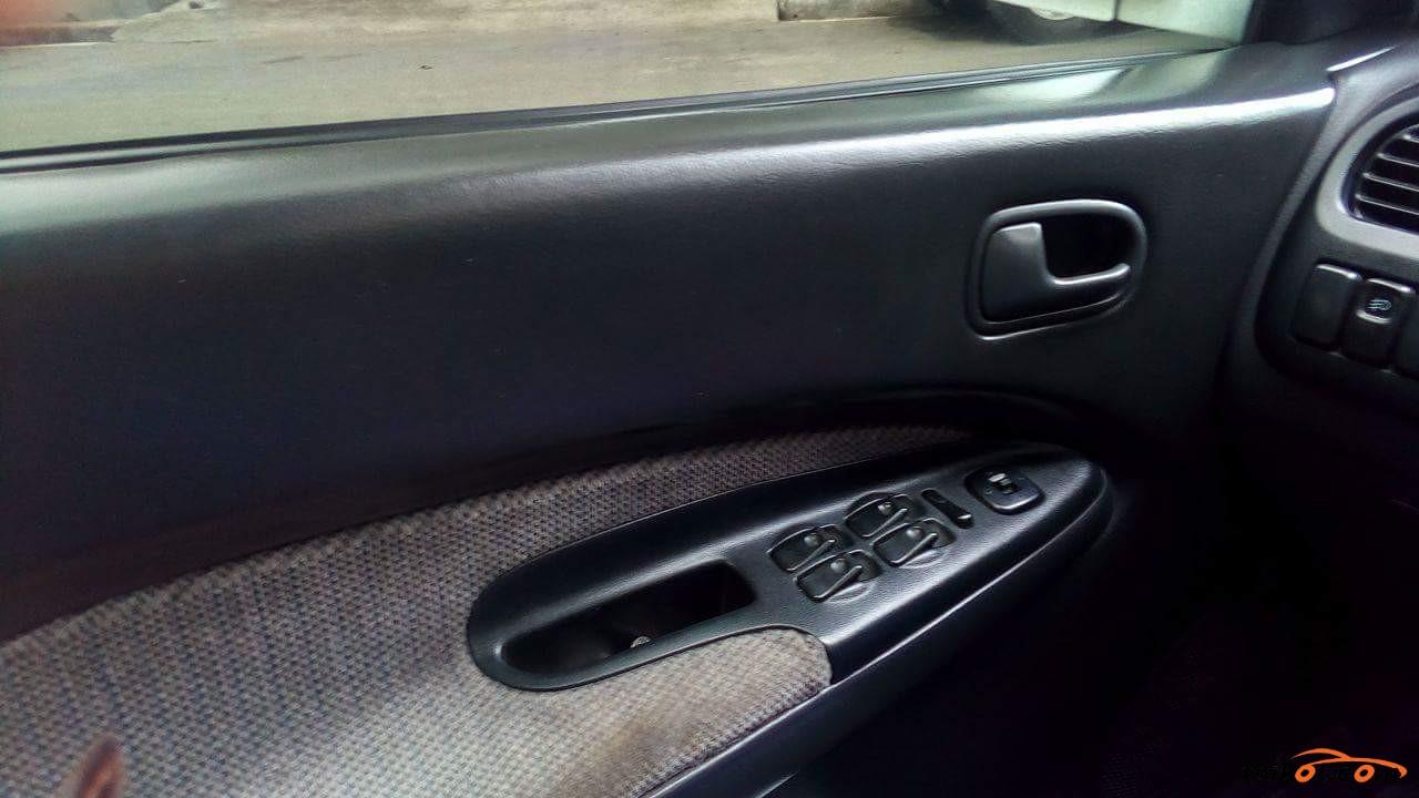 Mazda 323 1996 - 4